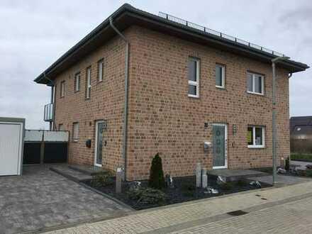 Erkelenz - Neubau Erdgeschoss mit Garten und Garage im Zweifamilienhaus