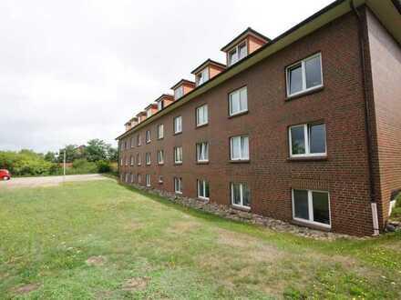 Günstige 1-Zimmerwohnung im Dachgeschoss mit sichtbaren Holzbalken!
