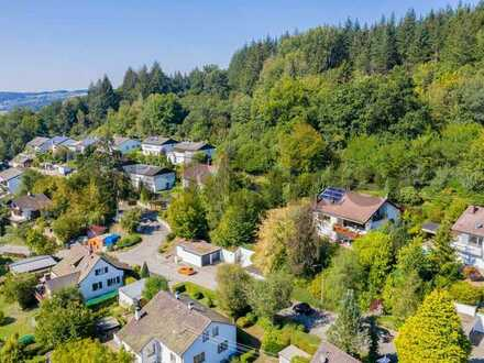 Idyllisches Baugrundstück für Ihr Traumhaus mit Doppelgarage in familienfreundlicher Waldrandlage