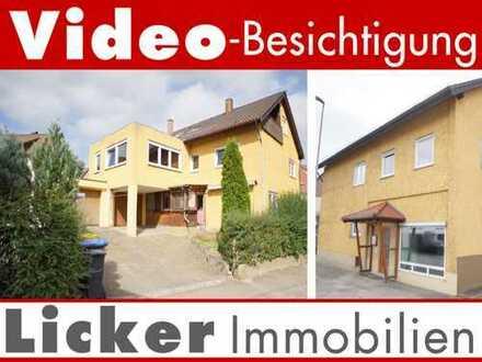 * Großes Mehrfamilien-Wohn- und Geschäftshaus.