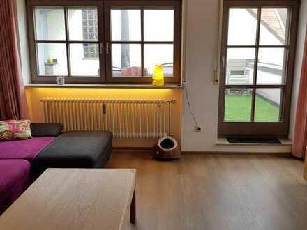 Zentrale, stilvolle 3-Zimmer-Wohnung mit Terrasse, Einbauküche und TG-Stellplatz