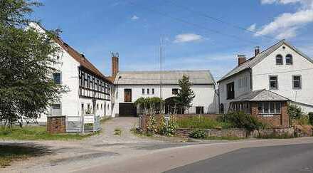 Wohn- und Gewerbegrundstück in Oberwartha: 2 Wohnungen, Büro, Werkhalle und Lagerfläche