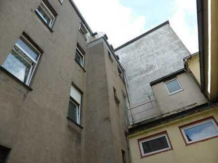 2 Mehrfamilienhäuser, 2 Garagen, kleine Halle & 2 Ladenlokale