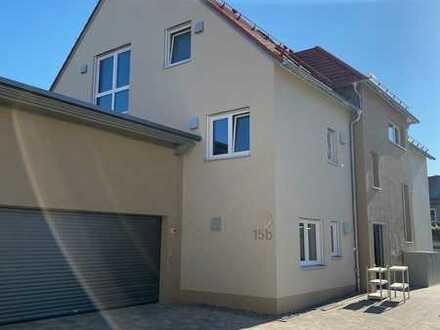 Erstbezug! Helle 3-Zi-Wohnung mit Garage, Stellplatz und Balkon