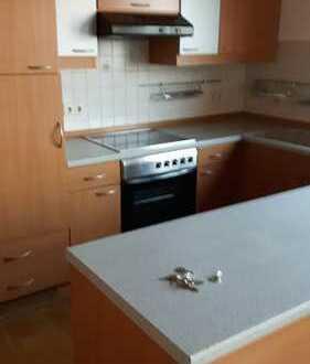 Günstige, gepflegte 3,5-Zimmer-DG-Wohnung mit Einbauküche in Hennweiler