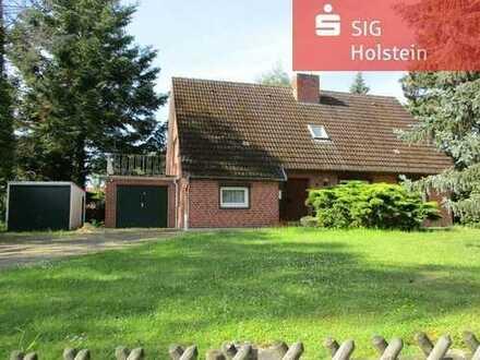 Für Handwerker: Einfamilienhaus mit 2 Garagen auf großem Grundstück in 23738 Damlos