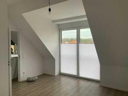 Freundliche 2-Zimmer-Dachgeschosswohnung mit Balkon und EBK in Marktheidenfeld