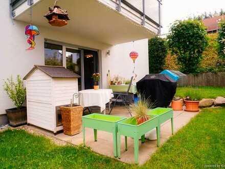Sonnige 4-Zimmer-Wohnung mit Garten, Tiefgarage und weiteren Stellplätzen