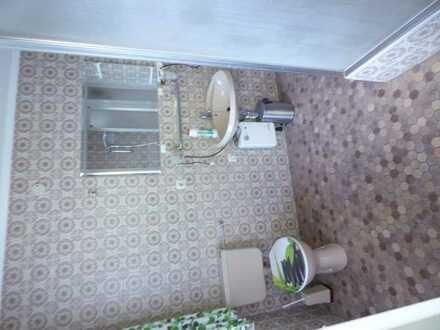 Gepflegte 1-Raum-Hochparterre-Wohnung mit Balkon und Einbauküche in Bad Rippoldsau