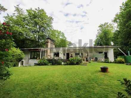 Wohnkomfort im Waldidyll: Großzügige Villa mit ELW, Garten-Oase und mögl. weiterem Baugrundstück