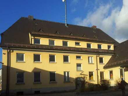 Attraktives Wohn- und Geschäftshaus mit Entwicklungspotential