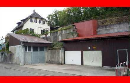 Einfamilienhaus mit Werkstatt, Garagen und Schuppen