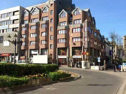 Zentral gelegene 4-Zi.-Wohnung in Ärzte-/Wohn-/Geschäftshaus mit priv. Garage