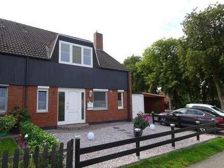 Top gepflegte Doppelhaushälfte mit teilüberdeckter Terrasse, Garage, Carport in Bremen-Rekum