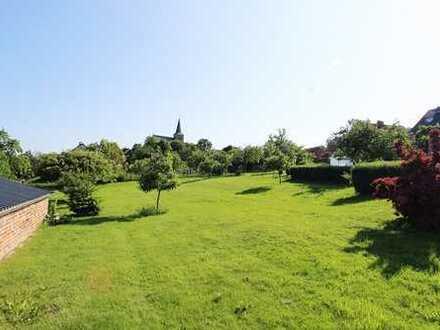 Bauplatz inkl. 2 Familienhaus in Hoof zu verkaufen