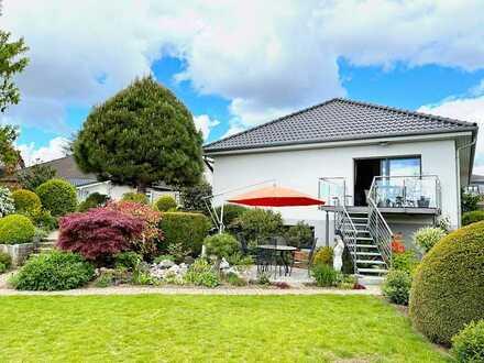 Sie suchen besten Wohnkomfort auf einer Ebene in ruhiger Wohnlage, sonnigem Garten und schönem Ausbl