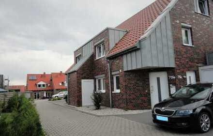 Schöne helle Dachgeschosswohnung im Energiesparhaus mit großer Dachterreasse, Garage und Stellplatz