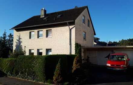 Großzügiges Wohnen mit Garten - Zweifamilienhaus mit Keller auf 3 Ebenen in Paderborn Schloß Neuhaus