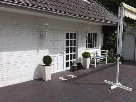 Erstbezug nach Renovierung: Familienfreundliche 4 Zimmer-EG-Wohnung mit EBK, Terasse, großer Garten