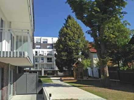Moderne Neubauwohnung mit Terrasse und Garten