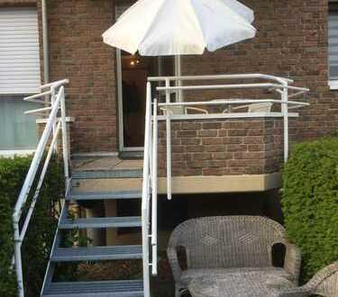 Beste RHEINLAGE: Charmante 1-Zi. Wohnung mit Balkon und kl. Garten
