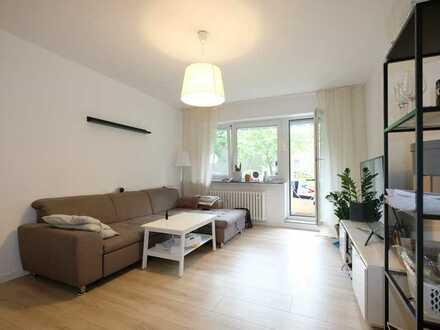 Renovierte 4,5 Zimmer mit Balkon, Badewanne und Blick ins Grüne!