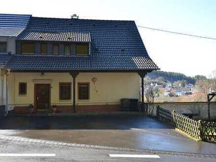 Geräumige Doppelhaushälfte mit schönem Garten und großer Garage bzw. kleiner Halle Birresborn