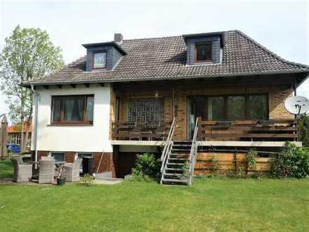 Einfamilienhaus mit Kaminofen und S/W - Terrasse!