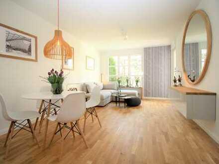 Eigener Garten mitten in der Stadt: Exklusive, komplett möglierte 2-Zimmerwohnung in Neuhausen