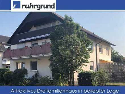 gepflegtes Dreifamilienhaus mit großem Garten und 2 Garagen in Brechten!