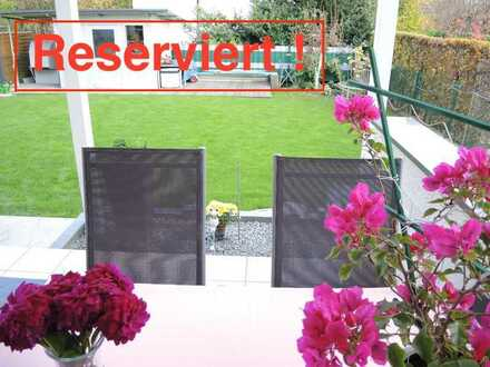 Neuwertige Erdgeschosswohnung mit einem wunderschönen Garten