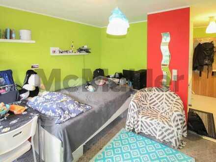 Modernisiert: Vermietetes Apartment mit Terrasse und TG-Stellplatz in ruhiger und grüner Lage