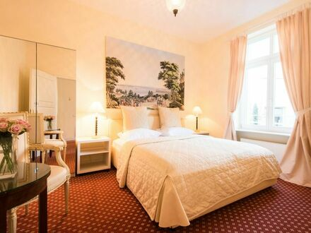 Ruhiges Apartment mit Balkon und Gartenblick
