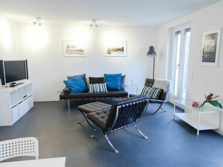 Moderne, elegante 2-Zi-Wohnung im obersten Stock mit Weitsicht