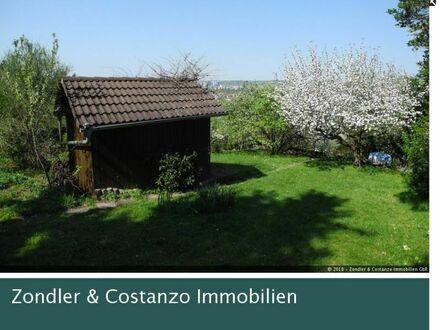 Ein Garten zum Entspannen: 2 Holzhäuser, mehrere Stellplätze, Wasseranschluss u.v.m.
