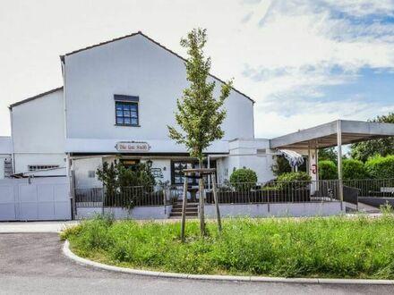 Wohn- und Geschäftshaus am Ortseingang von Altrip