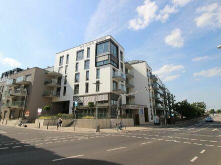 Erstbezug: Großzüzig geschnittene Etagenwohnung mit Balkon in zentraler Stadtlage