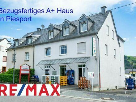 REMAX - Piesport offeriert A+-Gebäude mit vier bezugsfertigen Wohn- und Arbeitsebenen in der Bahnhofstraße 1