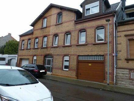 Beidseitig angebautes 1-2 Familienhaus mit Terrasse, Balkon und Garten