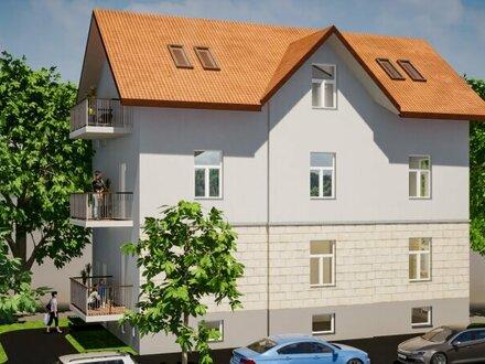 Leben in einer Stadtvilla im Ceconi-Stil: Exklusive 3-Zimmer-Balkonwohnung im Hochparterre mit Charme