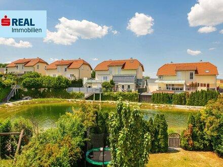 Doppelhaushälfte am privaten Badeteich - 130m² plus Keller, Garten, Terrasse, Garage und Parkplatz!