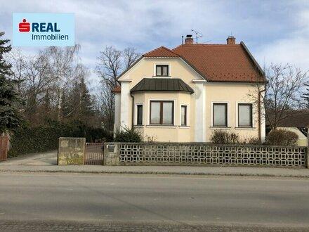 Einfamilienhaus mit Veranda und Atelier