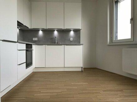ERSTBEZUG MIT DACHGARTEN in U-Bahn-Nähe: 2-Zimmer-Wohnung inkl. KÜCHE und großzügiger LOGGIA - PROVISIONSFREI direkt vo…