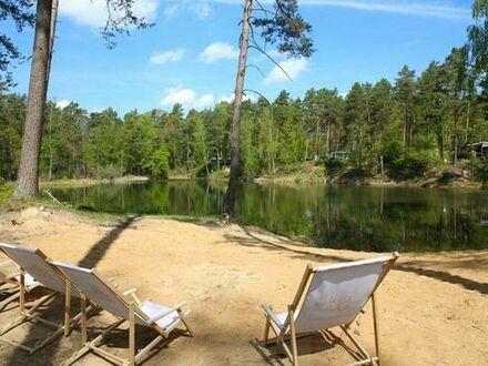 Campingplatz mit eigenem See in ruhiger Waldlage