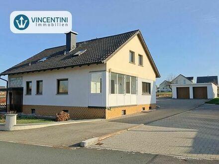 Bezugsfrei: Zweifamilienhaus mit großem Garten in Lisberg