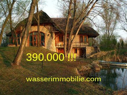 Haus direkt am Wasser zu verkaufen.