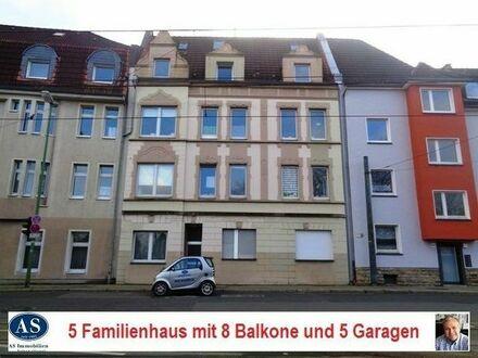 Wohnen und Vermieten., gepflegtes 5 Familienhaus mit 8 Süd-Balkone und 5 Garagen!