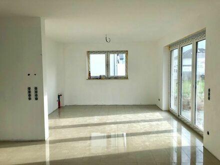 Neubau/Erstbezug: 3-Zimmer-EG-Wohnung mit Gartenmitbenutzung und Terrasse