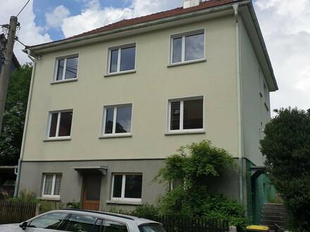 2-geschossiges Zweifamilienhaus mit Garage u. Garten