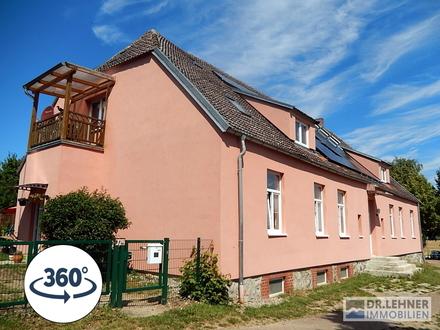 Dr. Lehner Immobilien NB -  In Müritznähe - Teilsaniertes Gutshaus mit 4 schönen Wohnungen